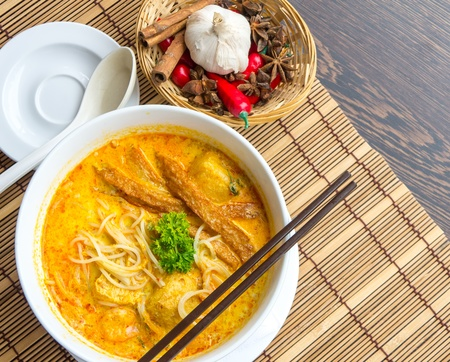 asian noodle: Hot and spicy Singapore Curry Noodle with decoration setup