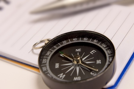 Close up view of the Compass on the white note-book as background Stock Photo