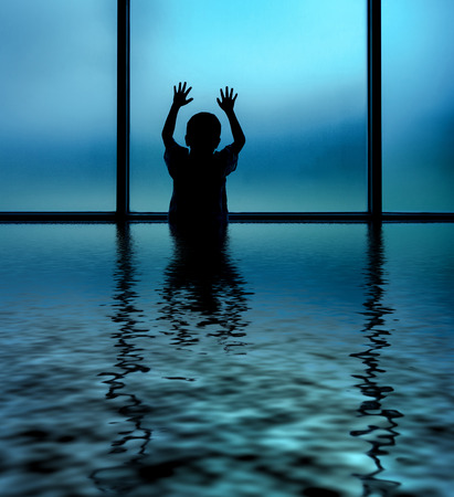 Kid standing and plays on window-digital compositing with water reflection ripple effects Stock Photo