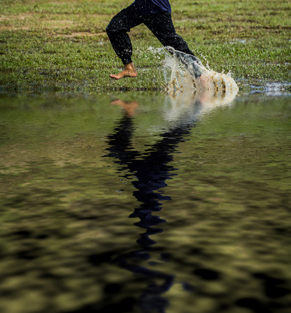 Kid runs with splash of water