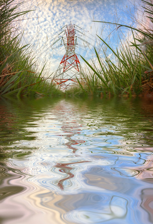 reflects: Electric cable pylon reflects on water