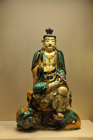 dynasty: Tri-color of the Ming dynasty Buddha statue Editorial