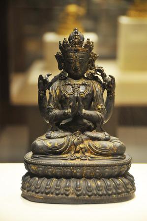 gilt: Four-arm gilt bronze goddess statue