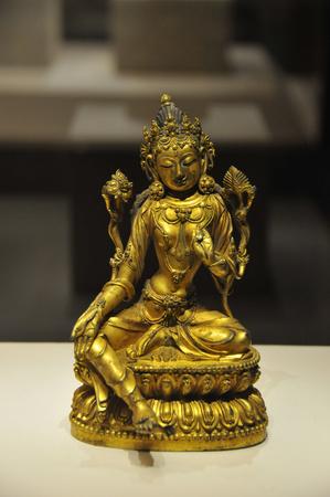gilt: Gilt patina Tara statue Editorial