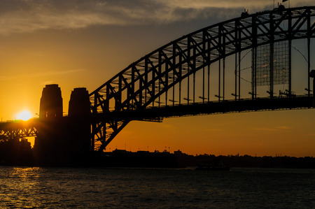 sideview: Sydney city landmarks side-view at sunset orange sky