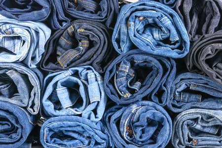 denim: Lot of different blue jeans close-up Stock Photo
