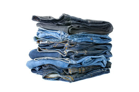 Lot of blue jeans isolated on white background photo