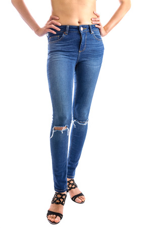 Jeans, Woman waist wearing jeans. Weight loss stomach closeup. Skinny jeans on a healthy slim fit body.