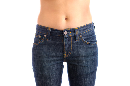 girl undressing: Jeans, Woman waist wearing jeans. Weight loss stomach closeup. Skinny jeans on a healthy slim fit body.