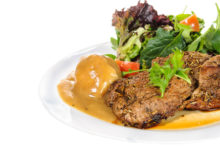 rump steak: Rump steak with mashed potatoes and mix vegetable on plate isolated on white background Stock Photo