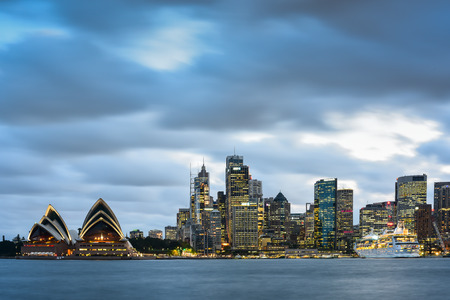 opera house: SYDNEY, AUSTRALIA - OCTOBER-3: Sydney Opera House and office building on October-3, 2014 in Sydney, Australia. The Sydney Opera House hosts over 1,500 performances each year that are attended by approximately 1.2 million people. Editorial
