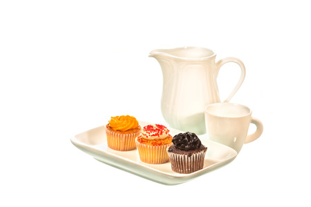 yello: Cupcake abd tea cup isolated on white background