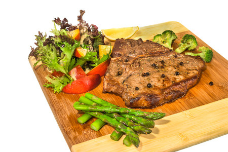 tbone: Grilled t-bone steak and vegetables on white background Stock Photo