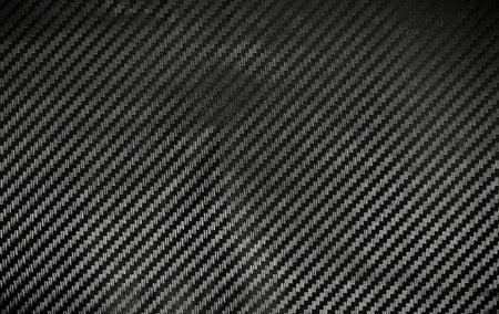 kevlar: Texture of Kevlar Carbon Fiber material. Dark background Stock Photo