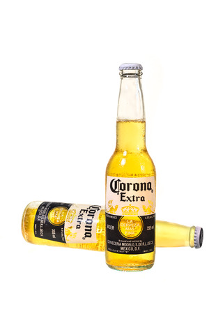 SYDNEY, AUSTRALIA -JANUARY 5, 2015: A Corona Extra Beer, on white background. Corona is the most popular  beer in Australia. Editorial
