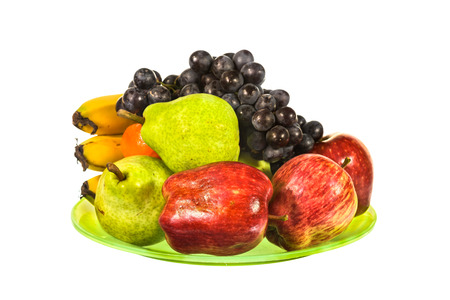 isolated on green: Mix fruit on green plate isolated on white background Stock Photo