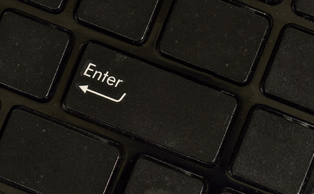 background information: Close up enter button black keyboard Stock Photo