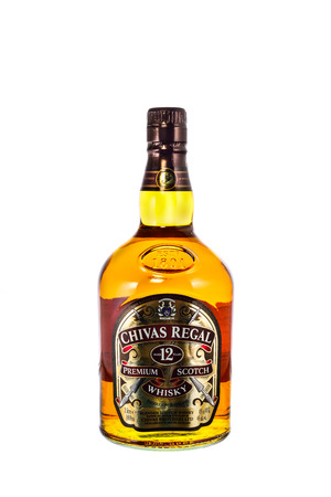 scotch whisky: SYDNEY, AUSTRALIA - February 9, 2016: Bottle of Chivas Regal on white background, Chivas Regal  Blended Scotch Whisky aged twelve years. Chivas Regal is a premium Blended Scotch Whisky produced by Chivas Brothers since 1801 Editorial