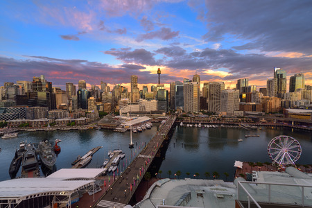 ferriswheel: SYDNEY, AUSTRALIA - December 20, 2016 : Sunset of Darling Harbour, adjacent to the city center of Sydney and also a recreational place in Sydney central business district