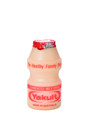 whithe: SYDNEY, AUSTRALIA - MAY 19, 2017: Yakult drink isolated on whithe background with clipping path. It was created by Japanese scientist in 1930. Yakult have a good microbe to help digest.