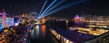 circular blue water ripple: SYDNEY, AUSTRALIA - June 11, 2017, Panorama of Sydney Circular Quay in illuminated with colourful light design imagery, during the Sydney Vivid show. Sydney 2017 annual public event.