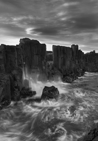 Landscape of Basalt rock formations with a view to the sea at Bombo Headland quarry, New South Wales, Australia