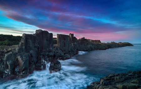 Basalt rock formations with a view to the sea at Bombo Headland quarry, New South Wales, Australia