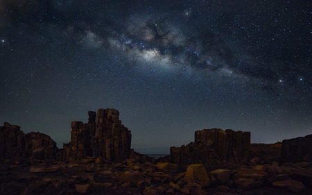 Milky way at basalt rock formations with a view to the sea at Bombo Headland quarry, New South Wales, Australia Stock Photo