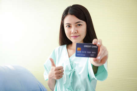 The patient holds a credit card to treat the disease. Get health benefits and more. Credit cards mockup. Hospital service concepts. insurance