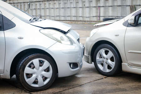 Car accident collision On the road when it rains, the road is slippery. The concept of car insurance against accidental damage.