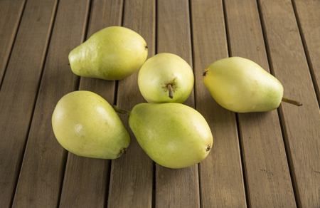 Fresh pears on wood organics.