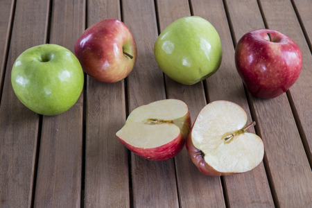 Ripe apples on wooden background. Stock Photo