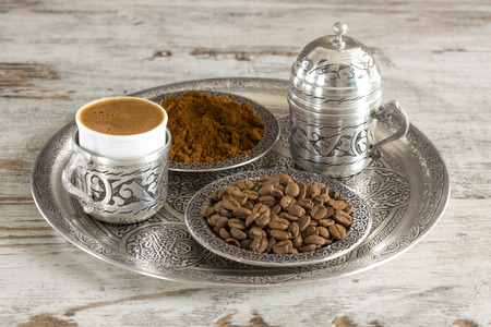 Turkish coffee with traditional presentation and coffee beans on wooden background. Stock Photo