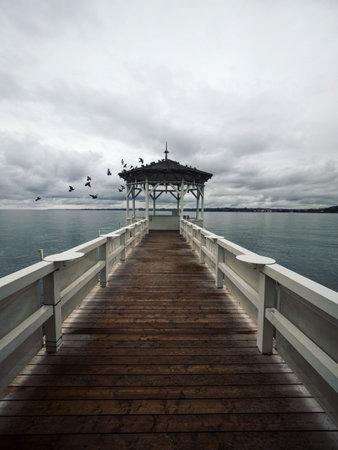 Lakeside waterfront esplanade pavilion gazebo elevated on wooden pier stilts in Lake Constance Bodensee Bregenz Austria Banque d'images