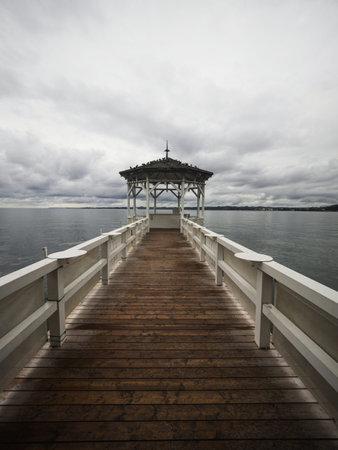 Lakeside waterfront esplanade pavilion gazebo elevated on wooden pier stilts in Lake Constance Bodensee Bregenz Austria