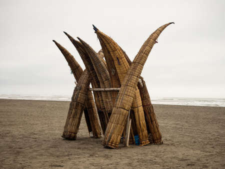 Traditional peruvian caballito de totora Balsa reed fishing boat raft canoe on Pimentel Beach Lambayeque Peru