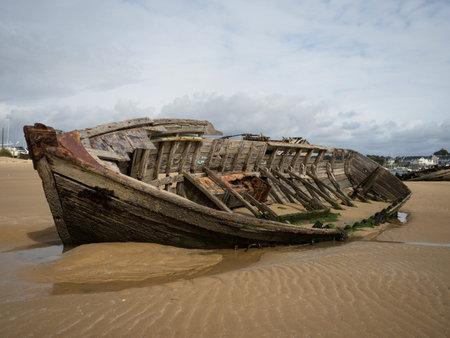 Stranded broken wooden shipwrecks on fishing boat naval graveyard marine cemetery in Magouer Etel river Brittany France