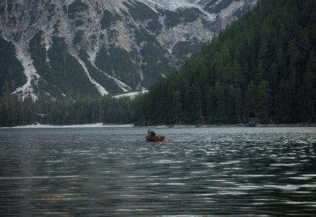 Wooden rowing boat panorama at Lago di Braies Pragser Wildsee alpine mountain lake Dolomites alps South Tyrol Italy