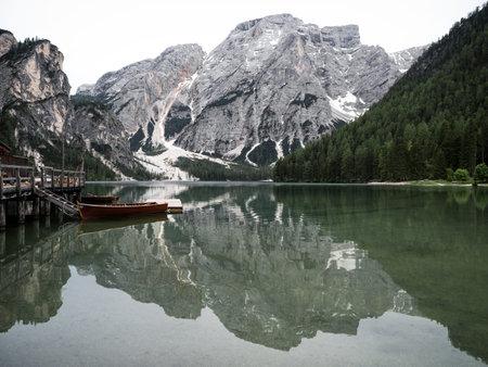 Panorama reflection boat house of Lago di Braies Pragser Wildsee alpine mountain lake Dolomites alps South Tyrol Italy
