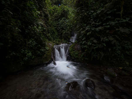 Panorama view of Cascada Madre waterfall in tropical rain cloud forest Mindo valley jungle Nambillo Ecuador andes