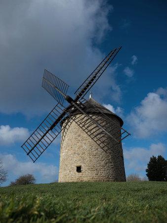 Old rustic historic windmill on a hill Mont Dol moulin Dol de Bretagne Saint Malo Ille et Vilaine Brittany France Reklamní fotografie