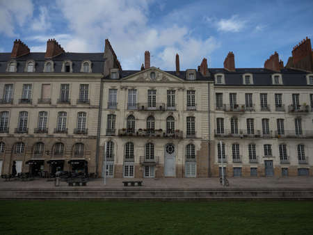Panorama view of crooked tilted sinking house building facade exterior ancient architecture Quai Turenne Nantes France Stock Photo