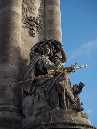 France de la Renaissance woman lady with golden gilded sword statue sculpture on Pont Alexandre III Paris France