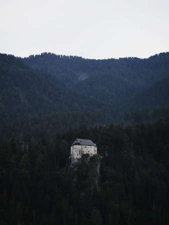 Aerial panorama view of isolated idyllic medieval historic stone rock hill cliff edge castle Schloss Stein in Dellach Drau Valley Kaernten Austria alps Europe