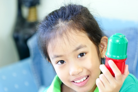 Portrait of cute young playing at home photo