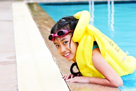 Girl play at the swimming pool