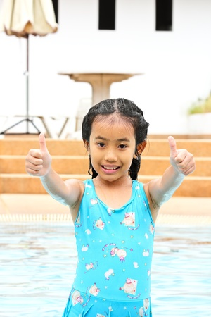 Very happy young girl in the swimming pool  photo