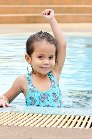 Girl are smiling and practice swimming