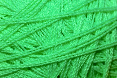 Close up detail of green yarn texture background photo