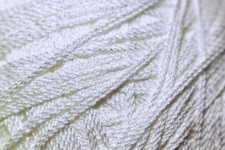 Close up detail of white yarn texture background photo